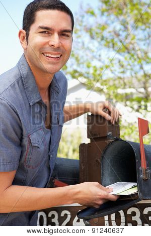 Hispanic Man Checking Mailbox