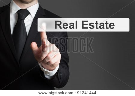 Businessman Pushing Flat Button Real Estate