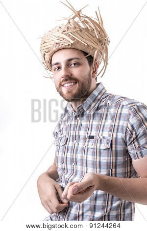 Man wearing caipira clothes. Can be used as Festa Junina or Country Festivals in Brazil