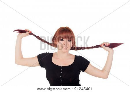 Teenage girl dressed in black with a piercing holding her braids isolated on white background