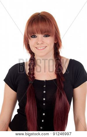 Teenage girl dressed in black with a piercing in the nose isolated on white background