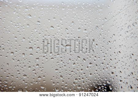 Photo of a glass full of water drops from rain