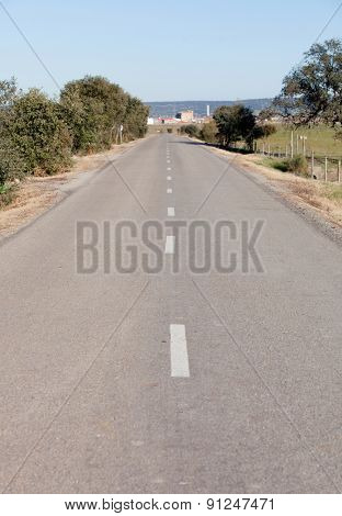 View of a country road in broken stripes