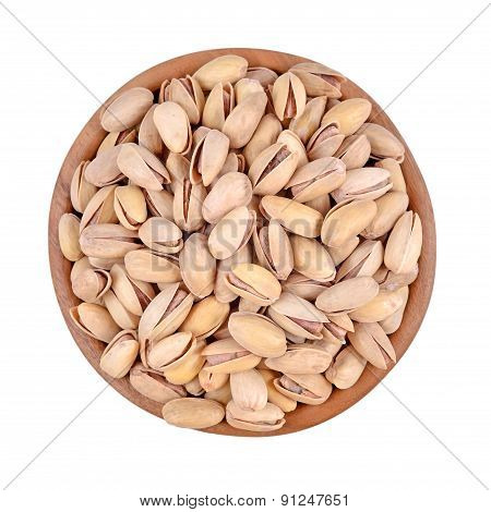 Pistachios In A Wooden Bowl On A White Background