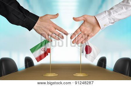 Iran and Japan diplomats agreeing on a deal