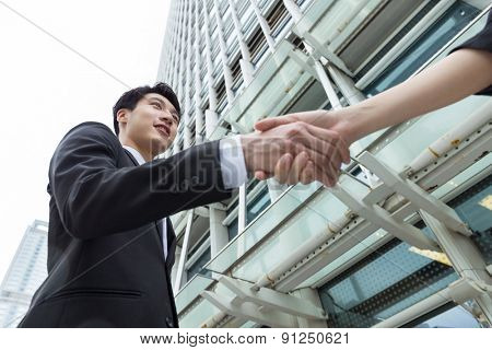 Asian businessman shaking hand