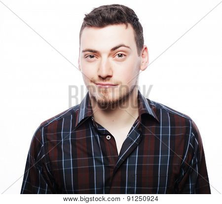 life style  and people concept: Handsome young man in shirt looking at camera