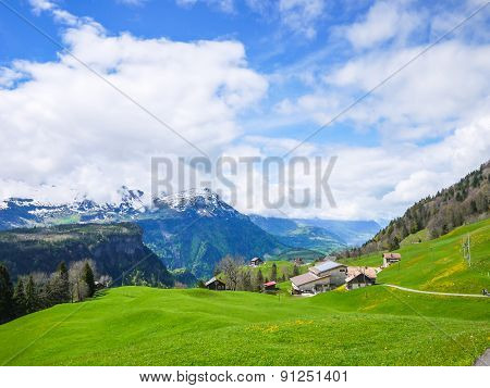 Mountains And Valley Of Swiss Alps