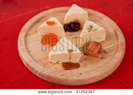 fresh butter set with different products as caviar jam salmon fish
