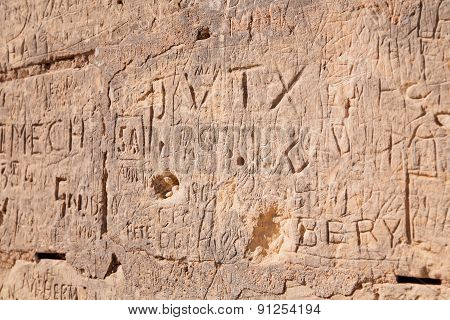 Ancient Carved And Scratched Wall In Mdina. Malta.