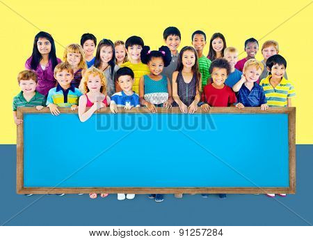 Multi-Ethnic Group of Children Holding Empty Billboard Concept
