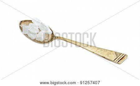 crystal sugar in an iron spoon isolated on white background