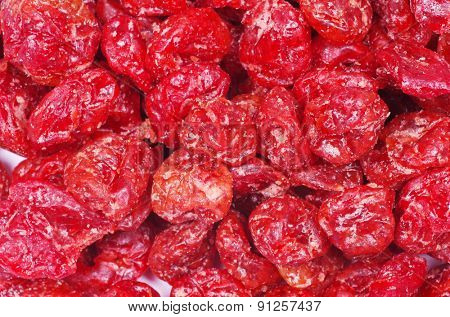 red dried goji berries on white
