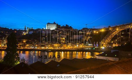 PORTO, PORTUGAL - MAY 15, 2015: View of Porto and the Dom Luiz bridge at night time. Porto is called Northern capital of Portugal. Municipality was founded in 1123. UNESCO World Heritage.