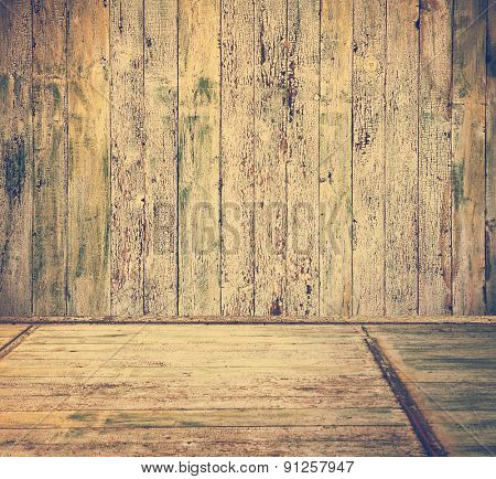 old grunge interior with wooden floor and walls, retro filtered, instagram style
