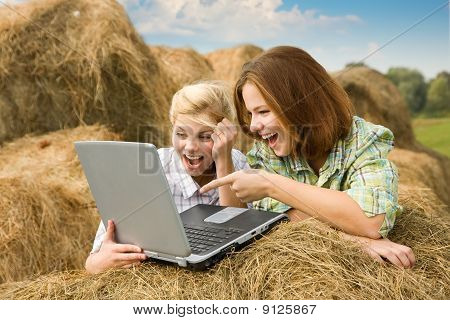 Happy Country Girls Relaxing With Laptop
