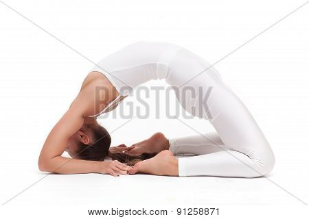 young beautiful woman yoga posing. isolated