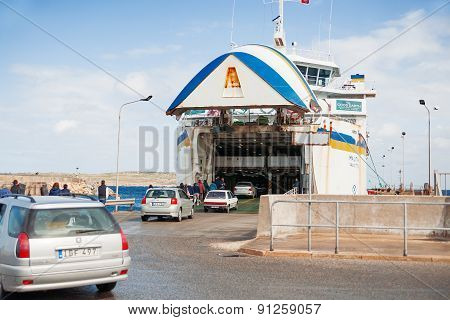 Cars waiting to board a ferry. Ferry crosses the Gozo channel in Cirkewwa Malta.