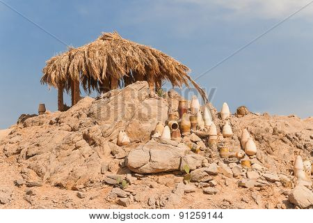 Beautiful Desert Landscape Of Egypt. Lonely Hut, Yellow Sand, Mountains, Clouds And Blue Sky.