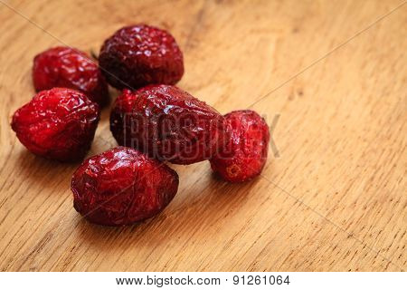 Dried Cranberry Fruit On Wooden On Table.