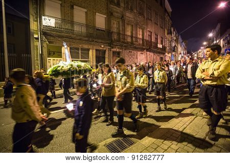 PORTO, PORTUGAL - MAY 13, 2015: Procession in honor of Our Lady of Fatima. Events at Fatima gained fame due to elements of secrets, prophecy and eschatology, particularly with regard to World War II.
