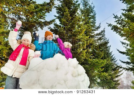 Happy kids playing snowballs game together
