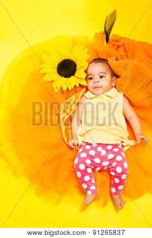 Sweet African baby in doted pants and yellow shirt