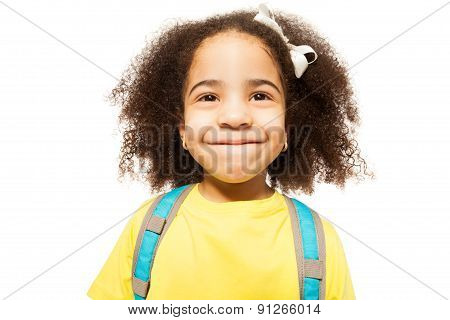 Portrait of small African girl in yellow T-shirt
