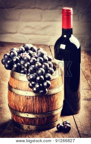 Bottle Of Red Wine And Bunch Of Grape