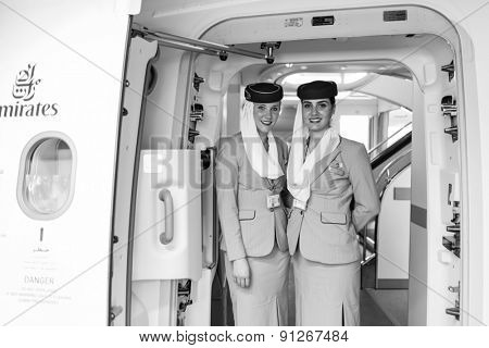 DUBAI - MAY 16: Emirates crew members meet passengers in Airbus A380 aircraft on May 16, 2014 in Dubai, UAE. Emirates handles major part of passenger traffic and aircraft movements at the airport.