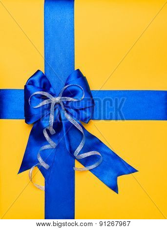 blue bow made from silk on yellow