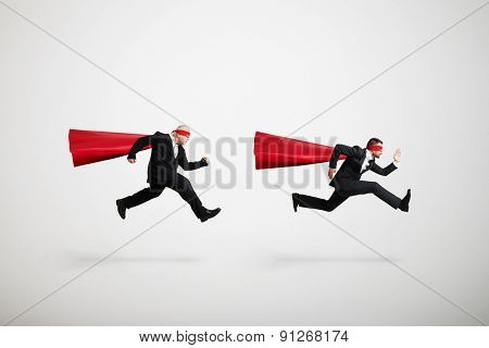 two men running over light grey background
