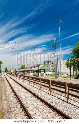 Railway goes to horizon near station Leptokarya, Greece