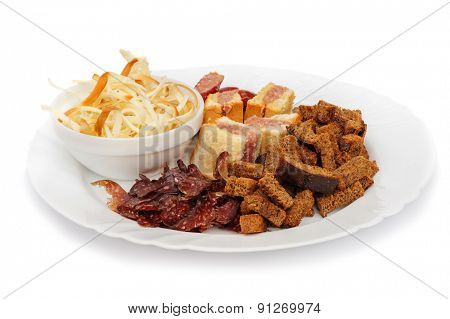 Ideal beer snack dish, dry sausage, crackers, cheese strips and mini-sandwiches