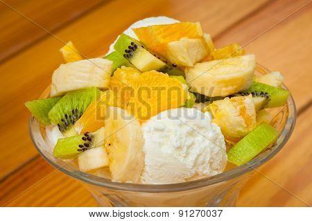 Orange, banana and kiwi fruit salad with icecream