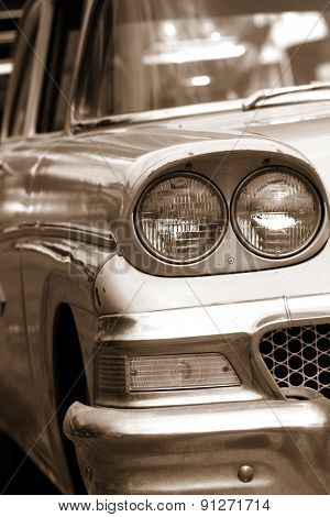 Classic car front end close up view in sepia color