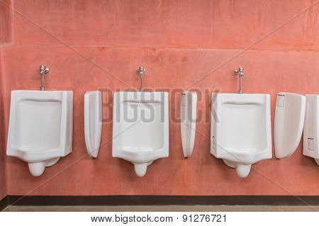 Urinal With Red Walls.