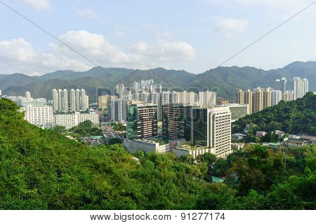 HONG KONG - APRIL 17, 2015: view on Sha Tin from the hill. Sha Tin, also spelt Shatin, is an area around the Shing Mun River in the New Territories of Hong Kong. Administratively,