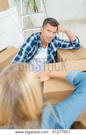 Couple amongst boxes