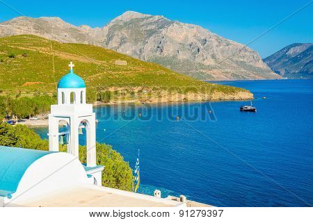 Blue dome of Greek church and sea, Greece