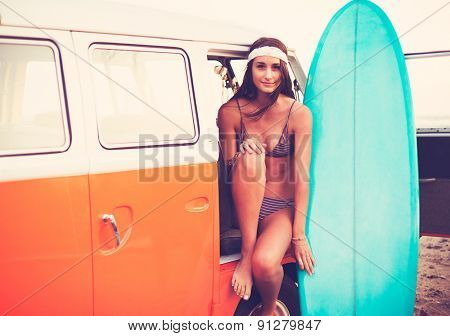 Beach Lifestyle, Beautiful Surfer Girl with Classic Vintage Surf Van on the Beach at Sunset