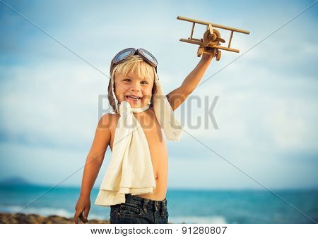 Small Boy Playing with Toy Airplane