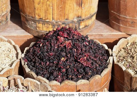 Dried Hibiscus Petals In Wooden Container On Street Stall