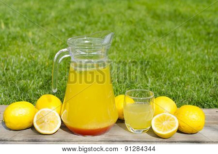 lemonade With Red Syrup On Wood