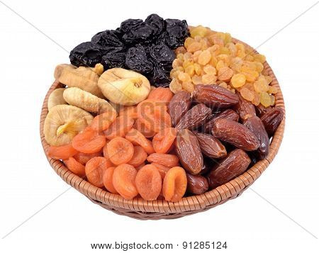 Various Dried Fruits In Wicker Bowl