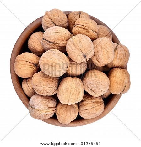 Whole Walnuts In A Wooden Bowl On A White Background