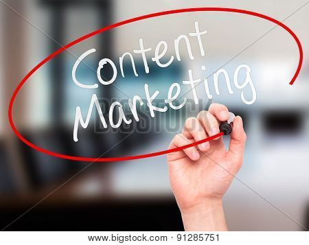 Man Hand writing Content Marketing with marker on transparent wipe board.