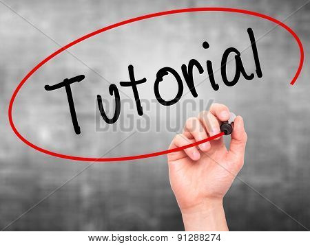 Man Hand writing Tutorial with marker on transparent wipe board.