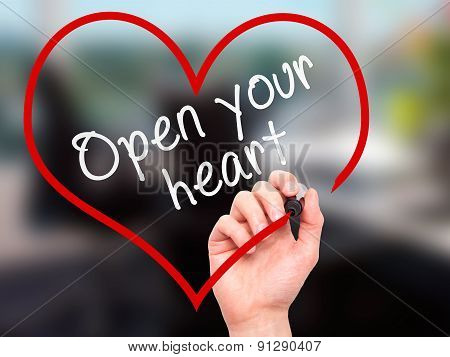 Man Hand writing Open your heart with marker on transparent wipe board.