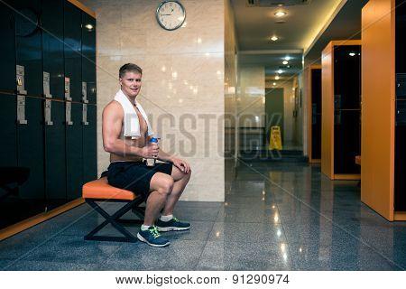 Sportsman in gym checkroom